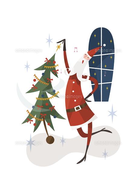 サンタとクリスマスツリー (c)イメージナビ