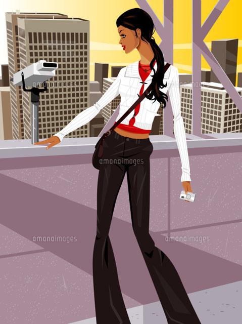 Woman beside binoculars (c)Greg Paprocki