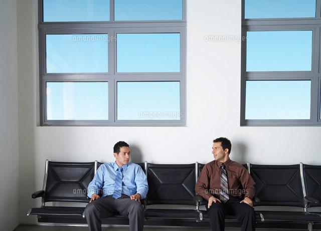 Businessmen in Waiting Area (c)Radius Images