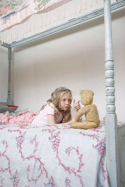 Girl Playing With Teddy Bear (c)Radius Images