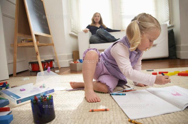 Girl Drawing on Paper (c)Radius Images