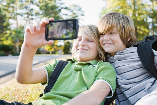 Boys taking Picture with Camera Phone (c)Radius Images
