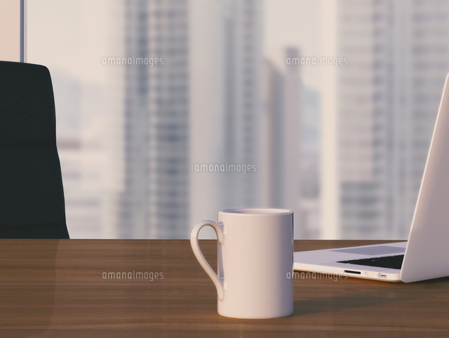 Digital Illustration of Desk with Arm Chair, Laptop and Mug in front of Skyline (c)Radius Images