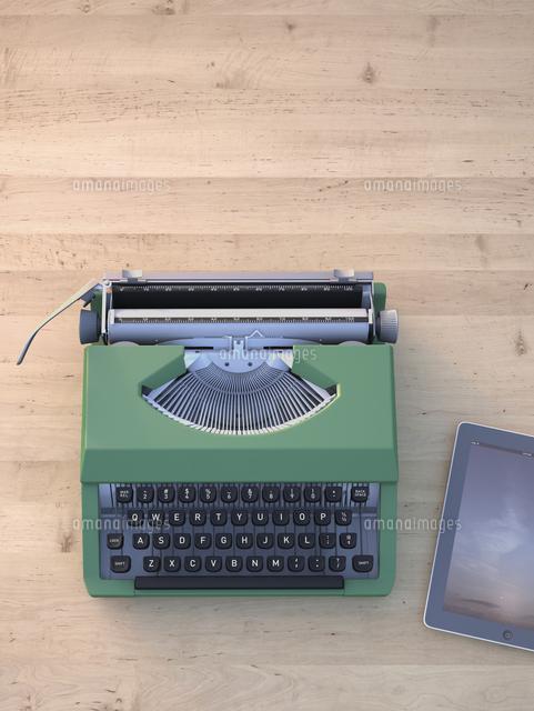 Digital Illustration of Old Typewriter and Modern Tablet Computer on Wooden Desk (c)Radius Images