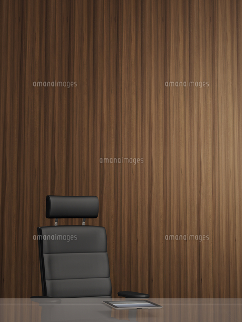 Illustration of office arm chair in front of wooden wall, tablet computer on glass table, studio sho