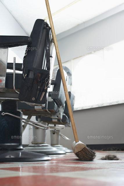 Broom beside barbers chairs (c)moodboard