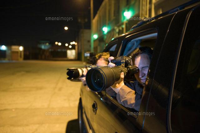 Paparazzi photographer in car (c)moodboard