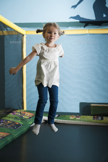 Young girl in mid air on trampoline (c)moodboard