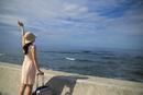 沖縄の海で左腕を空向けて伸びている女性