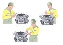 エンジン工場で働く作業着姿の男性