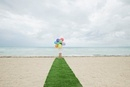 Girl standing on artificial turf on beach