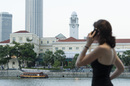 Woman on cell phone looking at view