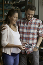 Couple looking at ultrasound photo together