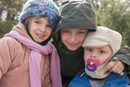 Young siblings dressed in winter clothing, portrait