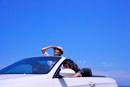 Three people sitting in the car and enjoying leisure activit