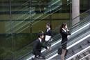 Business people on escalators