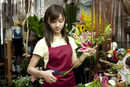 Female florist arranging flowers in the flower shop