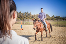 Young man riding horse
