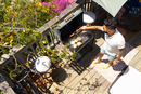 High angle view of mid adult man barbecuing