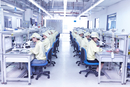 Quality check station at factory producing flexible electronic circuit boards. Plant is located in the south of China, in Zhuhai