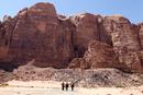 Three hikers hiking in Wadi Rum, Jordan