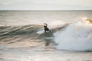 Surfer surfing ocean wave, Santa Barbara, California, USA