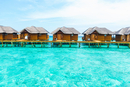 Water villas above turquoise ocean, Maldives