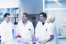 Scientists laughing in laboratory