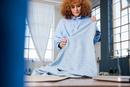 Dressmaker holding fabric