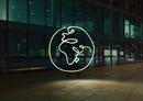 Illuminated planet earth symbol