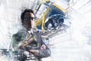 Conceptual image of businessman in car factory