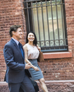 Businessman and woman walking together in street, smiling