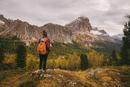 Hiker enjoying scenery, Mount Lagazuoi, Dolomite Alps, South Tyrol, Italy