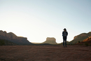 Woman standing in desert, looking at view, Sedona, Arizona, USA
