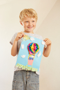 Boy holding up hot air balloon collage