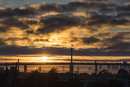 Bridge and skyline against cloudy sky during sunset, Melbourne, Victoria, Australia