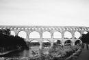 View of Pont du Gard over Gardon River against clear sky