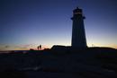 Silhouette lighthouse against clear blue sky