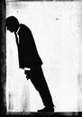 Illustrative image of depressed businessman leaning head on wall