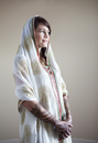 Caucasian woman with traditional Indian wedding clothing and