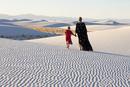 Caucasian mother and daughter walking in desert