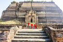 Asian women exploring temple ruins, Mingun, Saigang, Myanmar