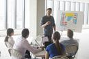 Businessman making presentation in meeting
