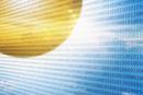 Sunbeams shining through binary code in blue sky