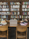 Empty chairs and table in library
