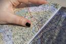 Close up of hand holding Paris city map, Paris, Ile-de-France, France