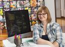 Caucasian businesswoman smiling at computer