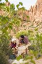 Hispanic couple reading map on remote trail