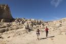 Caucasian mother and children hiking in desert