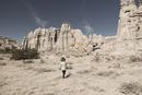 Caucasian preschooler boy walking in desert